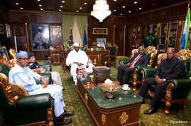 Gambian President  Yahya Jammeh meets with with the West Africa head of delegation during the election crisis mediation at the presidential palace Banjul, Gambia, Dec. 13, 2016