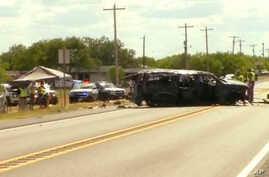 This frame grab from video provided by KABB/WOAI in San Antonio shows the scene where authorities say multiple people are dead as an SUV carrying more than a dozen people crashed, Sunday, June 17, 2018, in Big Wells, Texas.