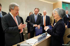 U.N. Secretary-General Antonio Guterres greets Kang Kyung-wha, South Korea's Foreign Minister, at the Human Rights Council at the United Nations in Geneva, Switzerland, Feb. 26, 2018.