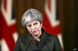 "Britain's Prime Minister Theresa May during a press conference in 10 Downing Street, London, April 14, 2018. May says the need to act quickly and protect ""operational security"" led her to strike Syria without a prior vote in Parliament."