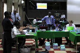Election clerks go through the re-tallying of votes after the Kenya Supreme Court issued an order in the ongoing presidential poll petition in Kenya's capital Nairobi March 26, 2013.