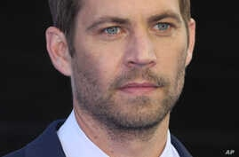 Actor Paul Walker arrives for the World Premiere of Fast & Furious 6, at a central London cinema in Leicester Square, May 7, 2013.