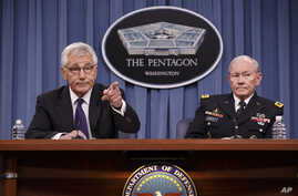 Defense Secretary Chuck Hagel, left, accompanied by Joint Chiefs Chairman Gen. Martin Dempsey brief reporters about ongoing operations against Islamic extremists in Syria and Iraq during a news conference at the Pentagon.