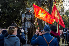 A man wearing old army uniform salutes to the monument of late Yugoslav leader Josip Broz Tito after the unveiling ceremony in Podgorica, Montenegro, Dec. 19, 2018