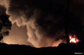 Smoke and flames are seen near Mezzah military airport, outside Damascus, Syria, in this still image from video obtained by Reuters Jan. 13, 2017.