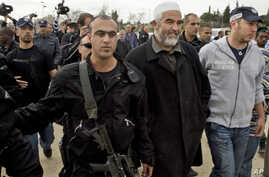 FILE - Sheik Raed Salah, the leader of the Islamic Movement in Israel, second right, is detained by Israeli policemen during an event to mark Jerusalem as the Capital of Arab Culture.