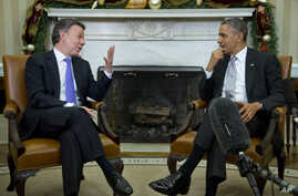 President Barack Obama meets with Colombian President Juan Manuel Santos in the Oval Office of the White House in Washington, Dec. 3, 2013