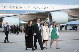 ObamaMark and Jackie Barden, parents of seven-year-old Daniel (L), walk with Nelba Marquez-Greene, mother of six-year-old Ana (C), and an unidentified woman from Air Force One after landing with President Barack Obama and other families who lost rela
