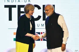 British Prime Minister Theresa May is greeted by her Indian counterpart, Narendra Modi, at the India-U.K Tech Summit in New Delhi, Nov. 7, 2016.