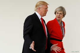 FILE - U.S. President Donald Trump escorts British Prime Minister Theresa May after their meeting at the White House in Washington.