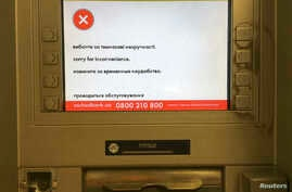 "A screen of an idle virus affected cash machine in a state-run OshchadBank says ""Sorry for inconvenience/Under repair"" in Kiev, Ukraine, June 28, 2017."