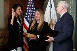 Vice President Mike Pence administers the oath of office to U.S. Ambassador to the UN, former South Carolina Gov. Nikki Haley,  Jan. 25, 2017, in the Vice Presidential Ceremonial Office in the Eisenhower Executive Office building.