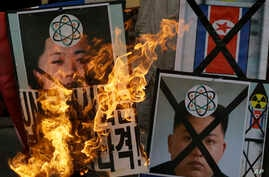 South Korean protesters burn the pictures of North Korean leader Kim Jong Un during an anti-North Korea rally following a nuclear test conducted by North Korea, in Seoul, South Korea, Feb. 12, 2013.