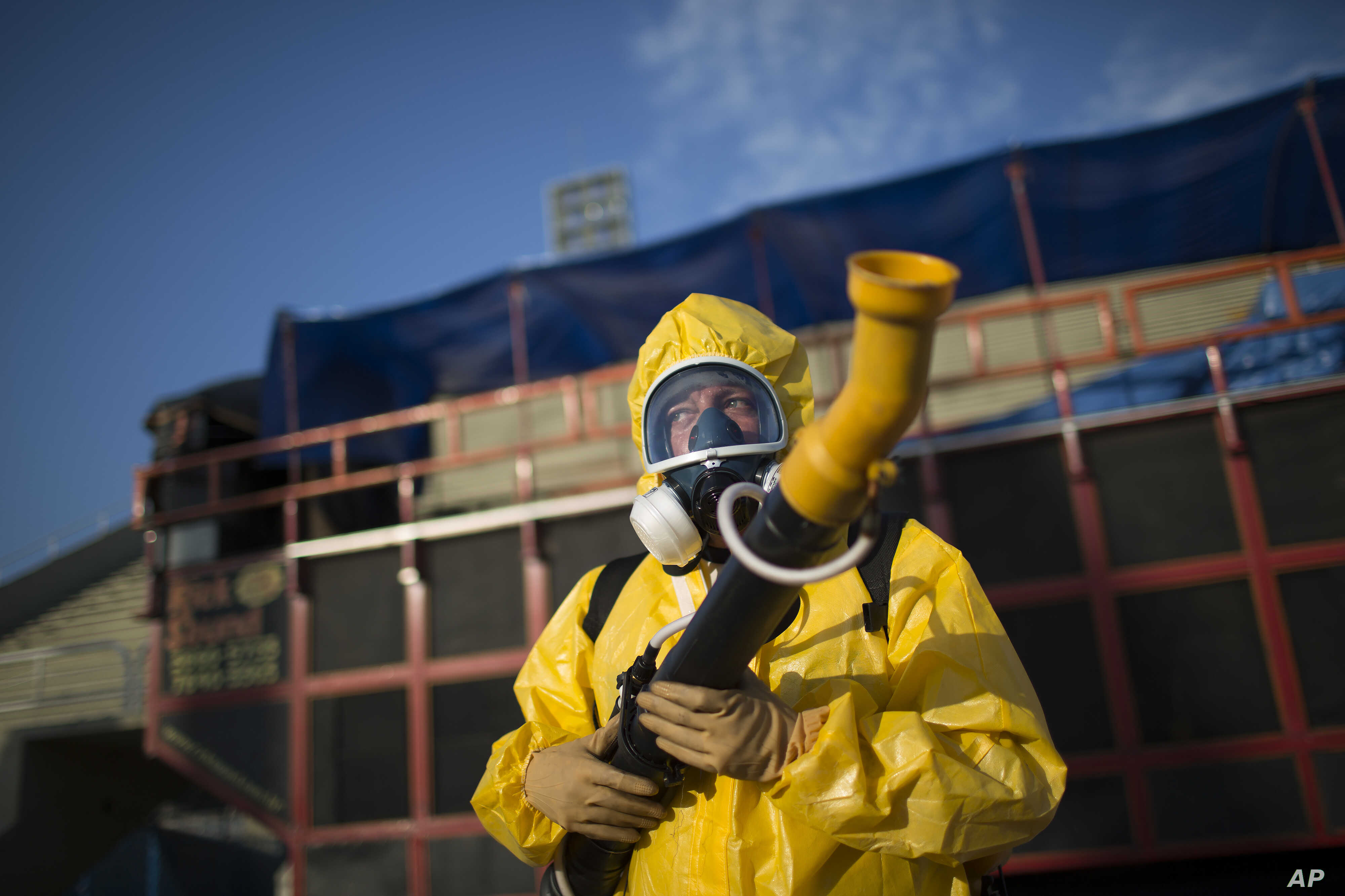 A health worker stands in the Sambadrome as he sprays insecticide to combat the Aedes aegypti mosquitoes that transmit the Zika virus, in Rio de Janeiro, Brazil, Jan. 26, 2016.