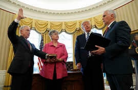 President Donald Trump watches as Vice President Mike Pence administers the oath of office to Attorney General Jeff Sessions, accompanied by his wife Mary, Feb. 9, 2017, in the Oval Office of the White House in Washington.