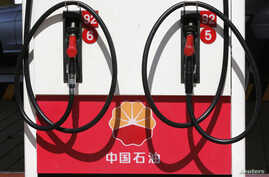 FILE - PetroChina's logo is seen at its gas station in Beijing.
