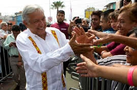 Presidential hopeful and two-time candidate Andres Manuel Lopez Obrador greets supporters as he arrives at a campaign rally for Delfina Gomez, who is running for Mexico state governor with his National Regeneration Movement, or MORENA, in Nezahualcoy...