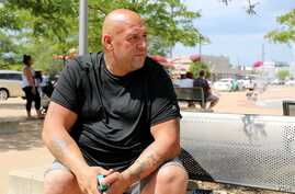 """Macomb County resident Jason Marchand supports Trump's policies, but views immigration in a different light. """"Everybody deserves to have a change of life and populate [Detroit] more,"""" he said."""" (R. Taylor/VOA)"""