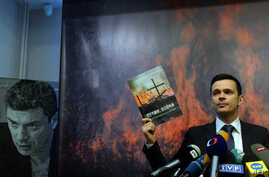 "Russia's opposition activist Ilya Yashin attends the presentation of the independent expert report entitled ""Putin. War"" in Moscow on May 12, 2015."