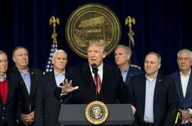 President Donald Trump, center, accompanied by from left, Senate Majority Leader Mitch McConnell of Kentucky, Vice President Mike Pence, House Majority Leader Kevin McCarthy of California, House Majority Whip Steve Scalise, R-La., and Secretary of St