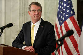 U.S. Secretary of Defense Ash Carter listens to French Minister of Defense Jean-Yves Le Drianin, Nov. 28, 2016,  in Washington. Carter makes his last trip to Asia next week to meet with U.S. allies.