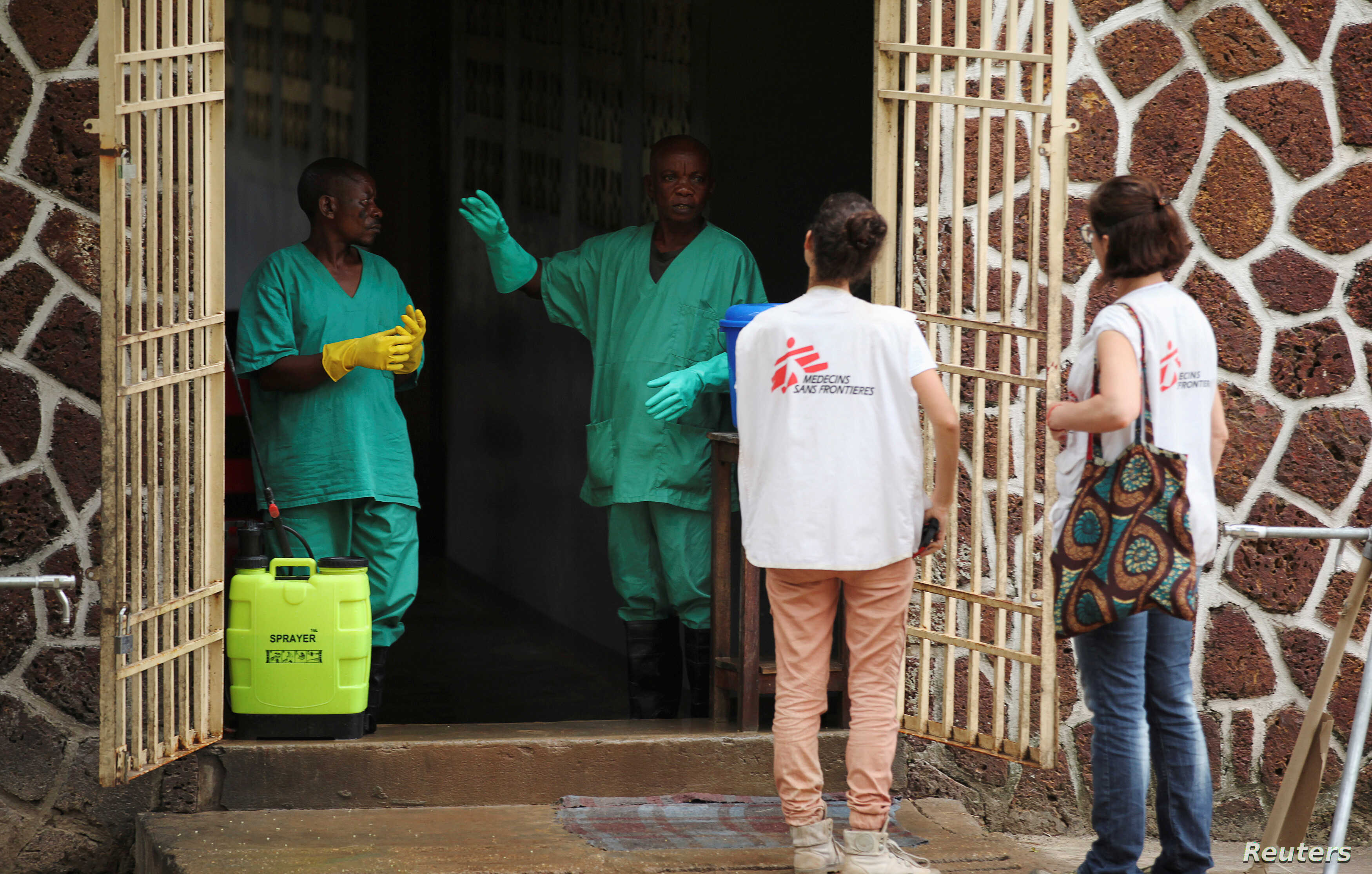 FILE - Medecins Sans Frontieres (MSF) workers talk to a worker at an isolation facility, prepared to receive suspected Ebola cases, at the Mbandaka General Hospital, in Mbandaka, Democratic Republic of Congo, May 20, 2018.