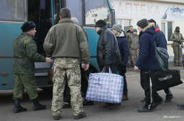 Prisoners of war (POWs) from the separatist self-proclaimed Luhansk People's Republic (LNR) board a bus during the exchange of captives near the city of Bakhmut in Donetsk region, Ukraine, Dec. 27, 2017.