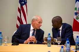 U.S. Homeland Security Secretary John Kelly (left) talks to Haiti's President Jovenel Moise during a press conference at the National Palace in Port-au-Prince, Haiti, May 31, 2017. Kelly traveled to Haiti for a brief visit less than two weeks after t