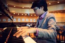 Joey Alexander checks out the piano at Dizzy's Club Coca Cola, a jazz club at Jazz at Lincoln Center. (courtesy ShoreFire Media)