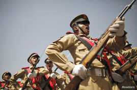 Military academy cadets march during a parade marking the 22nd anniversary of Yemen's reunification in Sanaa May 22, 2012.