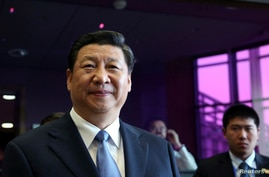 China's President Xi Jinping attends a meeting at the European Commission headquarters in Brussels, March 31, 2014.