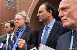 David Sidoo (2nd-R), along with attorneys Richard Schonfeld (L), David Chesnoff and Martin Weinberg (R), speaks outside Boston federal court after pleading not guilty to charges of participating in the largest college admissions fraud scheme in U.S. ...