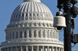 FILE - Surveillance cameras are visible near the U.S. Capitol in Washington.