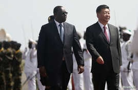 Chinese President Xi Jinping walks with Senegal's President Macky Sall after arriving at the Leopold Sedar Senghor International Airport, at the start of his visit to Dakar, Senegal, July 21, 2018.