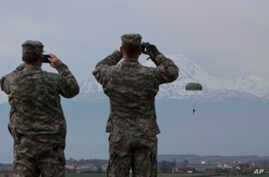 FILE - U.S Army soldiers of the 2nd Squadron, 38th Cavalry Regiment, part of the NATO-led peacekeeping mission in Kosovo watch fellow soldiers during a training exercise at U.S military base Camp Bondsteel, near the village of Sojeve in Kosovo, April