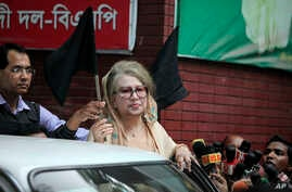Bangladesh's former Prime Minister Khaleda Zia holds a black flag as she stands at her office in Dhaka, Bangladesh, Jan. 5, 2015.