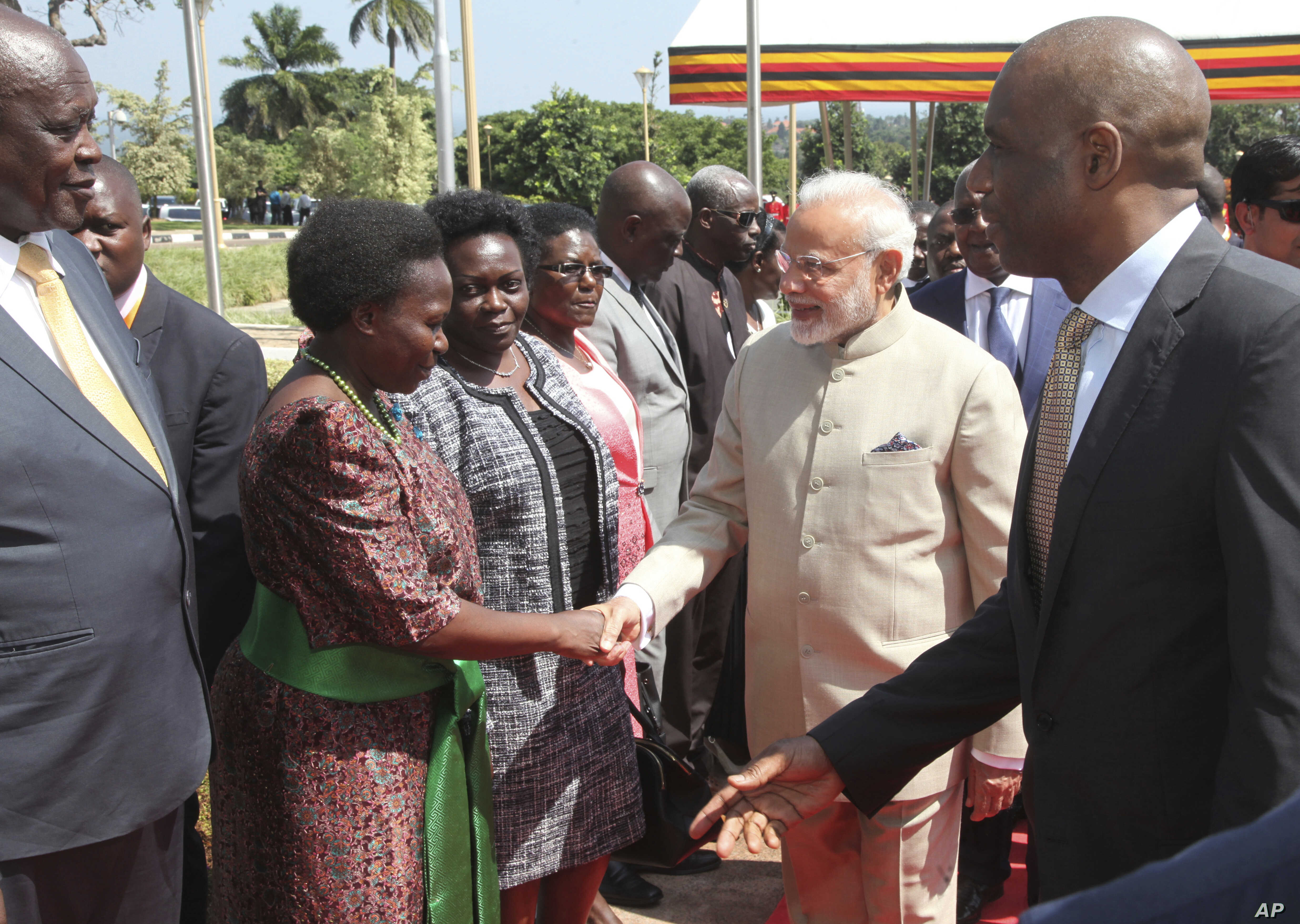 Indian Prime Minister Narendra Modi, centre, is received by Ugandan ministers and dignitaries at State House in Entebbe, about 42 Km from the capital Kampala, July 24, 2018.