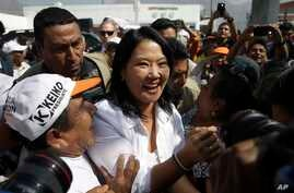 FILE - Presidential candidate Keiko Fujimori, center, of the Fuerza Popular political party, greets supporters as she campaigns in the San Juan de Lurigancho shantytown on the outskirts of Lima, Peru, May 10, 2016.