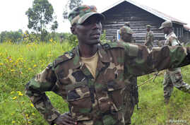 General Sultani Makenga, military leader of the M23 rebels, looks on while surrounded by his bodyguards at Mutaho, in eastern Democratic Republic of Congo, May 27, 2013.