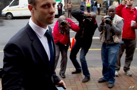 Oscar Pistorius arrives at the high court in Pretoria, South Africa, March 12, 2014.