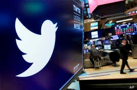 FILE - The logo for Twitter is displayed above a trading post on the floor of the New York Stock Exchange on Feb. 8, 2018.