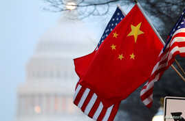 FILE - The People's Republic of China flag and the U.S. flag fly along Pennsylvania Avenue near the U.S. Capitol during Chinese President Hu Jintao's state visit in Washington, D.C., Jan. 18, 2011.