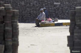 Members of the Muslim Brotherhood and supporters of deposed Egyptian President Mohamed Morsi rest amongst bricks stacked throughout their camp in the Nasr City area, east of Cairo Aug. 11, 2013.