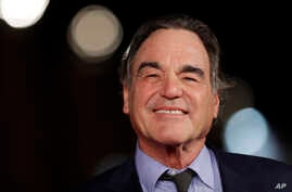 "FILE - Director Oliver Stone arrives for the screening of his movie ""Snowden,"" at the Rome Film Festival, in Rome. Showtime aired a series of interviews between Stone and Russian President Vladimir Putin over four days in June 2017."