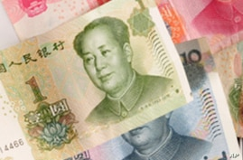 Analysts: US-China Debate Over Currency Misses Larger Issues