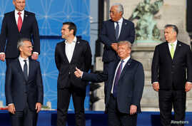 NATO Secretary General Jens Stoltenberg, Poland's President Andrzej Duda, Greek Prime Minister Alexis Tsipras, U.S. President Donald Trump, Portugal's Prime Minister Antonio Costa, Hungarian Prime Minister Viktor Orban pose for a group photo in the p...