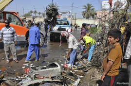 Street cleaners remove debris on the road after a car bomb exploded in Diwaniya province, 150 km (95 miles) south of Baghdad, April 29, 2013.