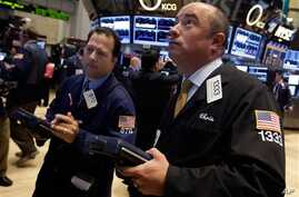 Trader Christopher Morie, right, works on the floor of the New York Stock Exchange Monday, Sept. 16, 2013. U.S. stocks and bonds are rising sharply in early trading after former Treasury Secretary Larry Summers withdrew from the race to become head o