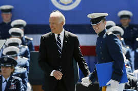 Air Force Number 1 Overall Graduating Cadet David McCarthy smiles after being congratulated by Vice President Joseph Biden during the commencement ceremony for the class of 2014, Wednesday, May 28, 2014.