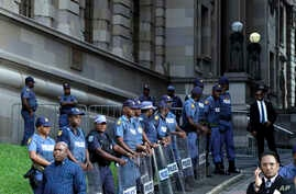 Police secure the entrance to the High Court in Durban South Africa, April 6, 2018.